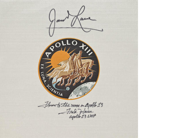 LOVELL AND HAISE SIGNED BETA EMBLEM CARRIED ON APOLLO 13.