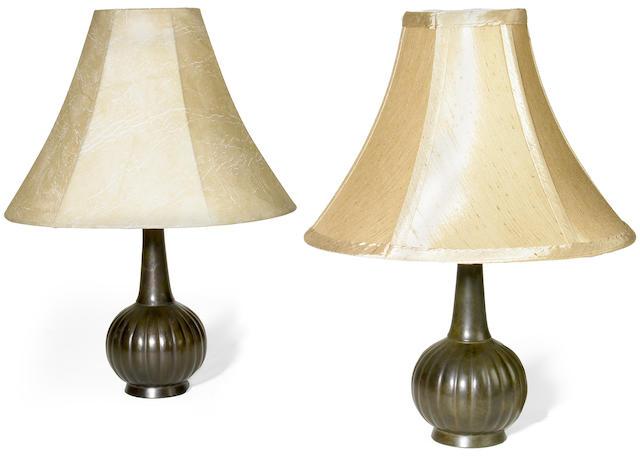 A pair of Just Andersen diskometal lamps