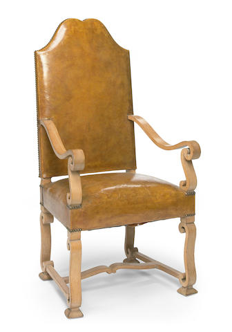 An oak and leather armchair in the manner of Jean Charles Moreaux
