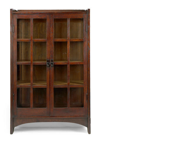 A Gustav Stickley glazed oak china cabinet  model #815, 1904-1912