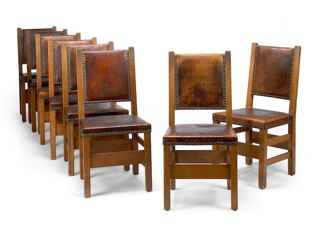 A set of eight Gustav Stickley oak and leather upholstered side chairs  1902-1903, model 1303