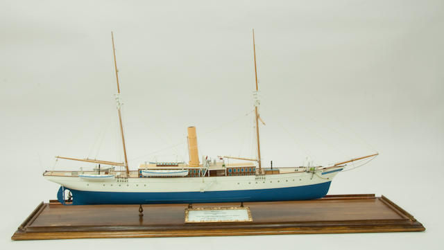 "A model of the steam yacht ""Nerissa"" In painted wood and composition ¼""=1' scale , with twin masts, deckhouse with skylights,(4)lifeboats on davits and single propeller, with card printed ""Nerissa"" Iron Hulled Steam Yacht 1885 Shipwright: Alexander Stephen & Sons Ltd., Glasgow. Owner: Alexander Stephen. Weight: 264 tons gross 125 tons net Draft: 12 feet 5ins Length 153 feet 8 inches Beam: 22 feet 1/2inch,"