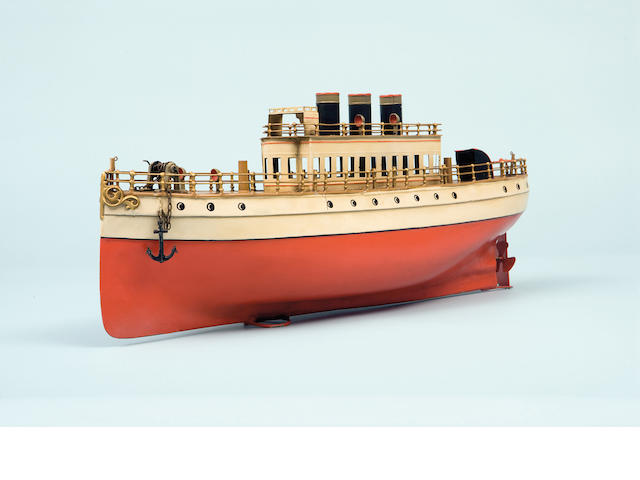A tinplate toy liner Attributed to Marklin (German, early 20th century) With clockwork motor, superstructure with three funnels and raised bridge (lacking masts, davits and three lifeboats)