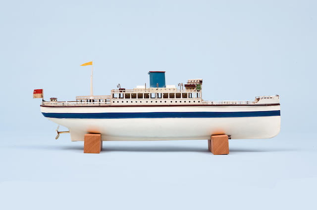 A Fleischmann tinplate toy liner German, 1950s Clockwork motor, white and blue livery (dented side and lacking lifeboats), 20 in. (51 cm.) length