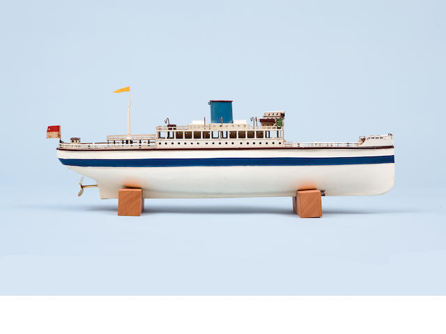 A Fleischmann tinplate toy liner  German, 1950s Clockwork motor, white and blue livery (dented side and lacking lifeboats),