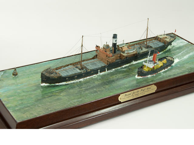 "A diorama ""Bound for the High Seas"" of the steam coaster ""Cordene"". by Robert H Mouat (British, 20th century) the models, in 1/6 in.=1 ft. scale, of the coaster being led out to sea by the steam tug ""Sun V"", set in in a modeled and painted sea, the hull weathered and well detailed with deck houses, port holes, boats on davits, ladders, railings, and other details. Displayed in a brass framed glass case with a mahogany base. 26-½ x 9 x 10 in.(67 x 23 x 25 cm.) cased."