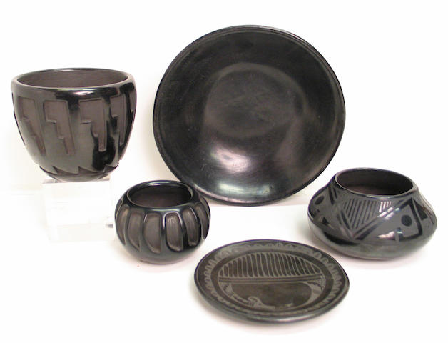 Five San Ildefonso or Santa Clara blackware vessels