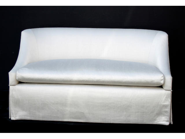 A pair of Contemporary beige silk upholstered sofas