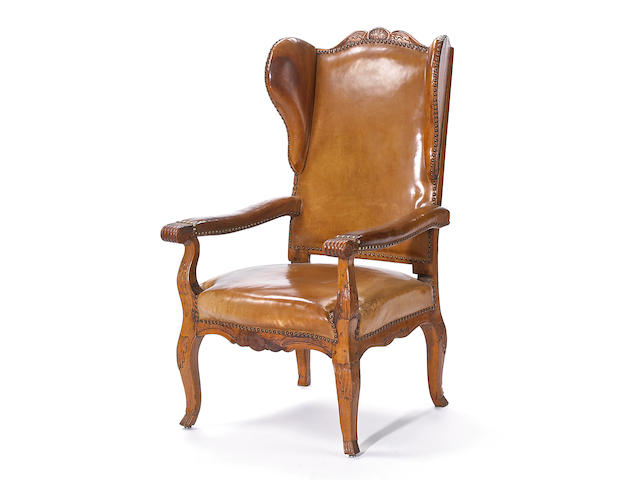 A Continental Rococo beechwood fauteuil aux oreilles