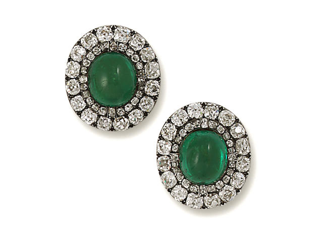 A pair of antique emerald and diamond clip brooches,