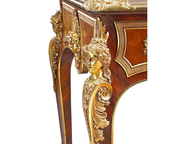 A Louis XV style gilt bronze mounted kingwood and mahogany bureau plat