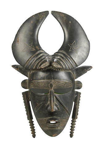 A Jimini mask with large curved horns height 16in