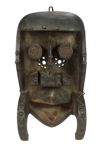 A Bete mask with large tubular eyes and large fangs height 12 1/2in