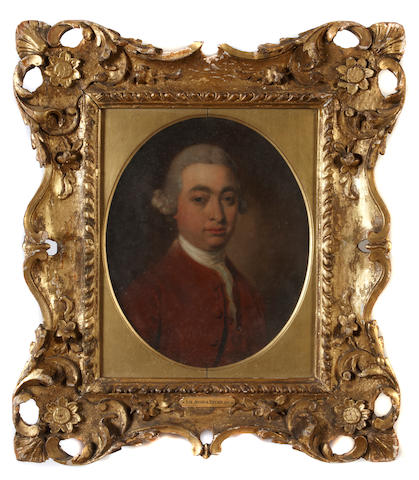 Follower of Sir Joshua Reynolds, PRA (British, 1723-1792) A portrait of a gentleman in a fine carved frame oval 11 x 9in