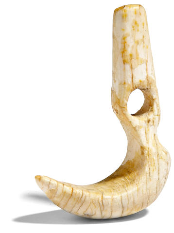 A hook-shaped ornament, niho palaoa, Hawaiian Islands