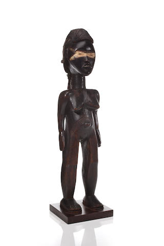 A Dan female figure, lü me, Ivory Coast