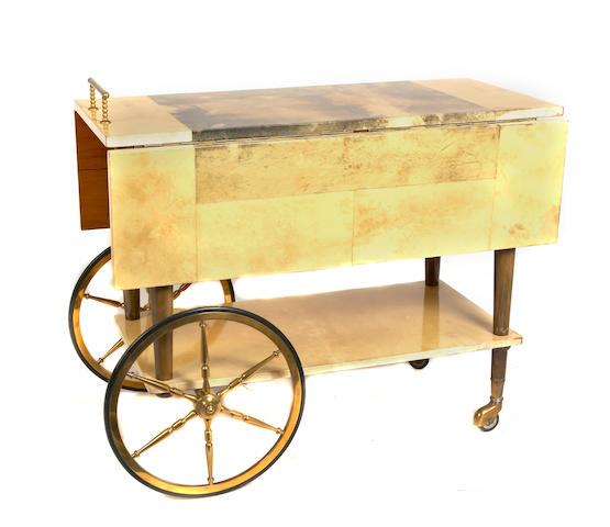 An Aldo Tura parchment and gilt metal bar cart