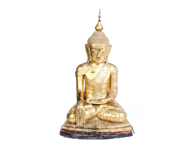 A monumental Southeast Asian gilt decorated carved wood seated Buddha