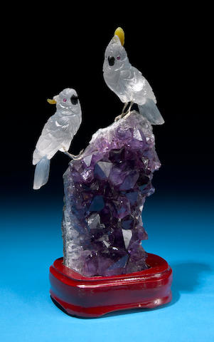 Pair of Rock Cystal Quartz cockatoos on amethyst base
