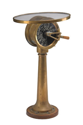 A marine brass engine room gauge on stand