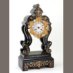 A Napoleon III ebonized and inlaid portico clock on stand