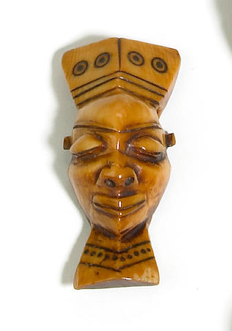 A Pende ivory pendant, ikoko, Democratic Republic of the Congo