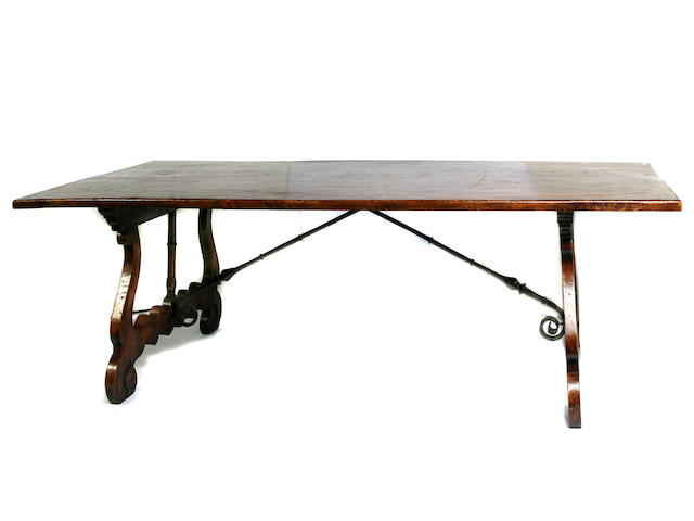 A Spanish Baroque style wrought iron mounted burl elm library table