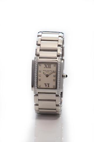Patek Philippe. A fine stainless steel and diamond lady's bracelet watchTwenty-4, Ref. 4910 / 010, Movement No. 1678455, Case No. 4150566