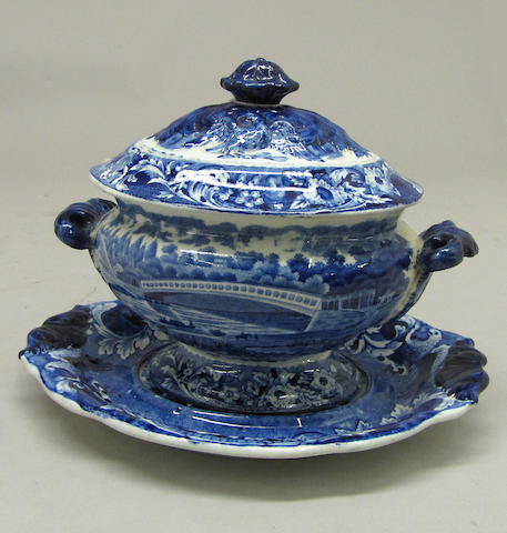A Joseph Stubbs American historical Staffordshire blue and white covered sauce tureen and stand: Upper Ferry Bridge over the River Schuylkill first half 19th century