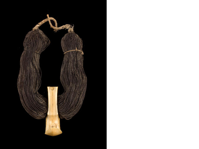 An important ivory, human hair and indigenous cordage necklace, lei niho palaoa, Hawaiian Islands