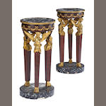 A pair of French Empire style faux rosewood gilt bronze mounted marble top gueridons<br>late 19th century
