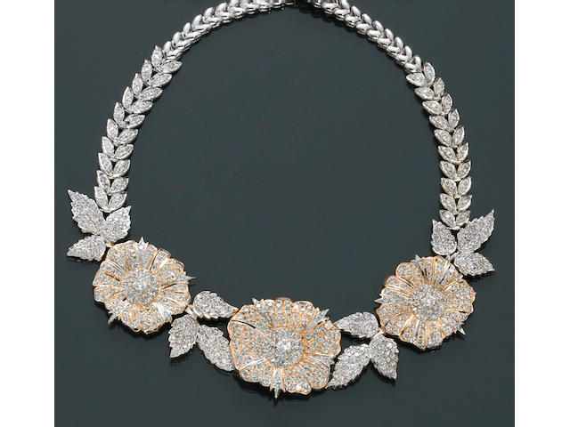 A diamond, rhodium and eighteen karat gold floral necklace