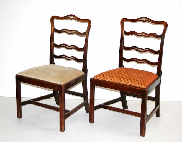 A set of three George III mahogany ladder back chairs