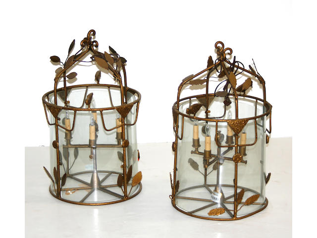 A pair of Continental gilt metal and glass four light lanterns