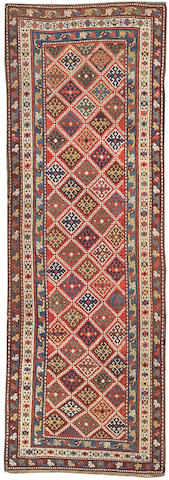 A Kuba runner Caucasus, size approximately  3ft. 11in. x 11ft. 4in.