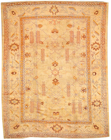 An Oushak carpet West Anatolia, size approximately 9ft. x 11ft. 6in.