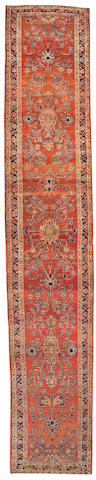 A Mohajeron Sarouk runner Central Persia, size approximately 3ft. 1in. x 16ft. 42in.