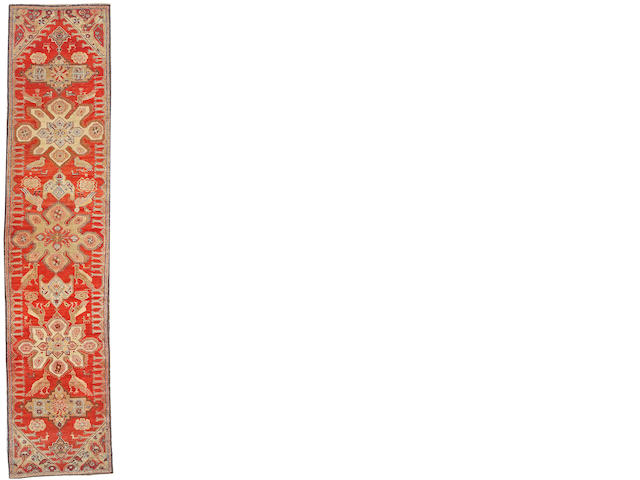 A Karabagh runner Caucasus size approximately 3ft. 7in. x 16ft. 6in.
