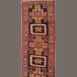 An Ardabil runner size approximately 3ft. 3in. x 10ft. 11in.