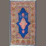 A Kerman Rug size approximately 3ft. x 5ft.