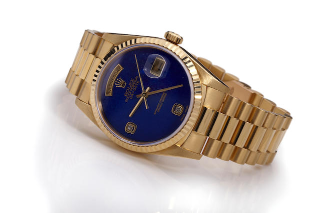 Rolex. A fine 18K gold automatic calendar bracelet watch with diamond-set lapis lazuli dial Oyster Perpetual Day - Date, Ref. 18238, Case no. W837091, sold 1998.