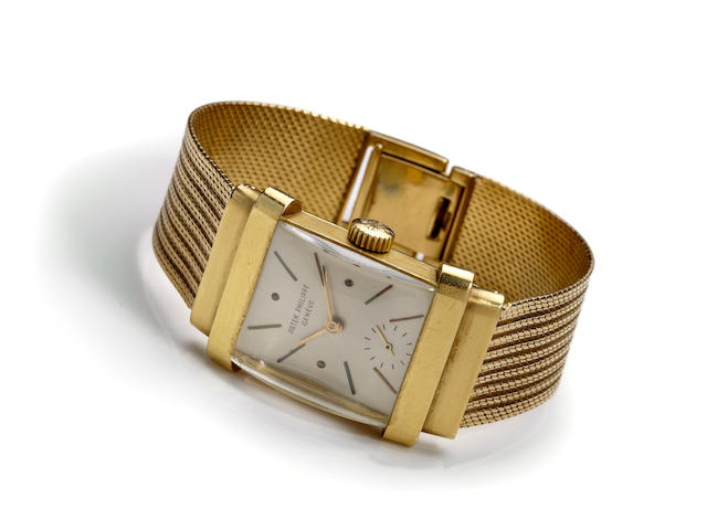 "Patek Philippe. A very fine 18K gold rectangular wristwatch and bracelet Ref. 1450, ""Top Hat"", Movement no. 977137, Case no. 688582, circa 1955-60"