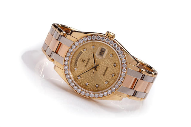 Rolex. An 18K three color gold and diamond automatic calendar bracelet watchTridor Day Date, Ref. 18948, case no. A666474, circa 1998