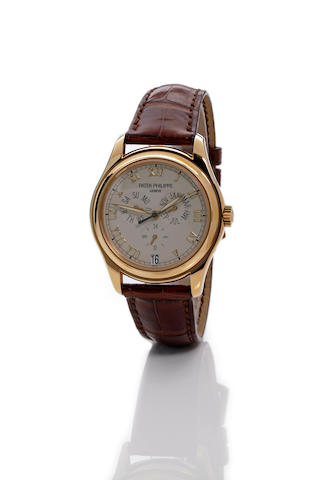 Patek Philippe. An 18K gold annual calendar automatic wristwatch with center secondsRef. 5035, movement no. 3137324, 1990's
