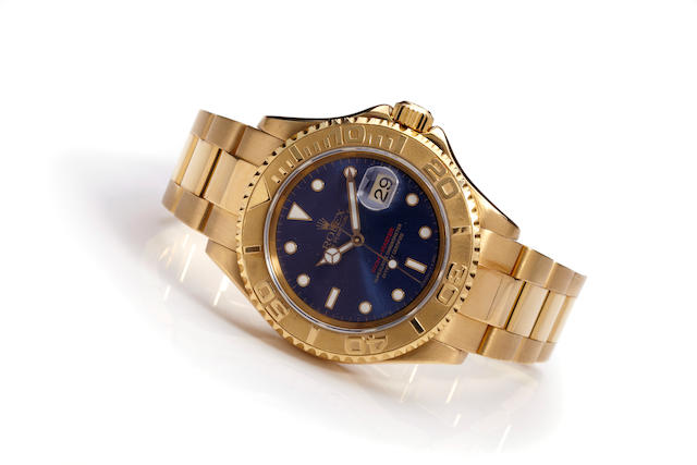 Rolex. An 18K gold automatic calendar bracelet watchOyster Perpetual Date Yachtmaster, Ref 16628, Case no. U140834, circa 1998