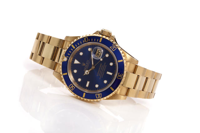 Rolex A fine 18K gold calendar bracelet watch, Submariner, Ref. 16618, Case No. T456678, Sold 1997
