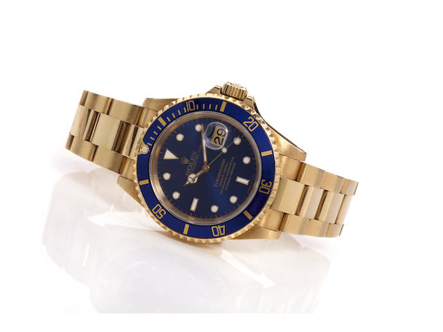 Rolex. A fine 18K gold calendar bracelet watchSubmariner, Ref. 16618, Case No. T456678, Sold 1997