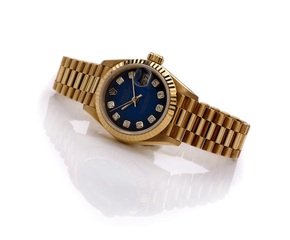A ladies Rolex 18k gold presidential wristwatch, with box and papers