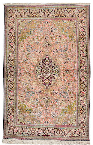 A silk Qum rug Central Persia, size approximately 4ft. 6in. x 6ft. 9in.