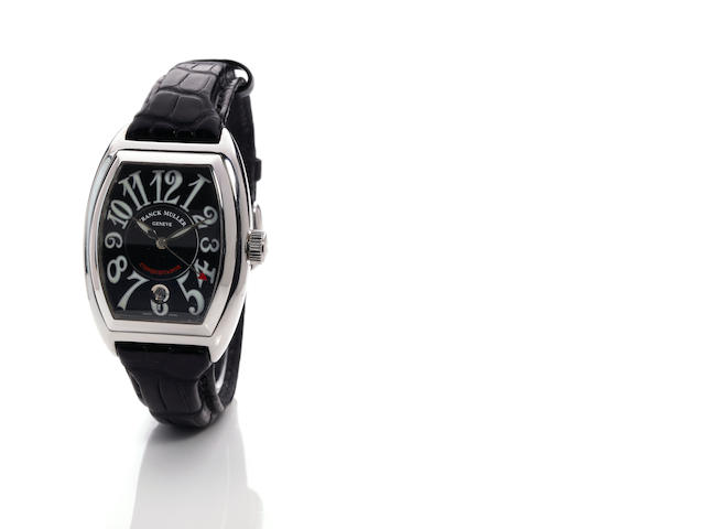 Franck Muller. An 18K white gold tonneau automatic calendar watch with center seconds Conquistador, No. 07